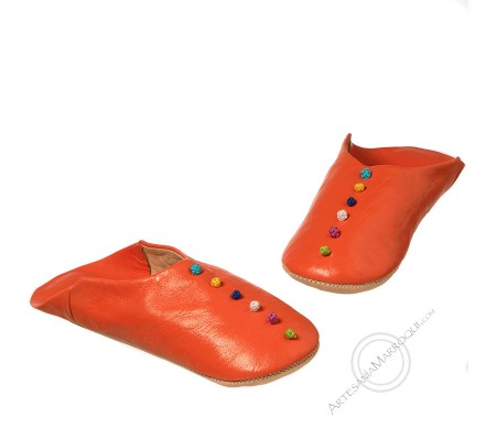 Orange pom pom slippers